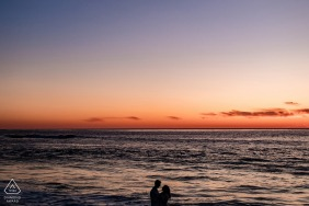 San Diego, Calif Engagement Couple Portrait - Image contains: beach, water, ocean, sunset, silhouette