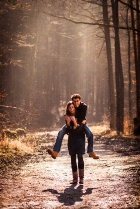 Tuebingen, Germany Bride carrying the groom on her back | Engagement Photography - Image contains: trail, hiking, forest, trees