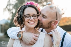 Oise Engagement Session with a couple - Portrait contains: watch, glasses, suspenders, flowers, hair, sunglasses