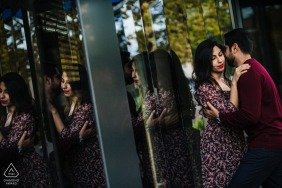 Bulgaria Engagement Photo Session - Portrait contains: love, holding, glass, reflect, windows