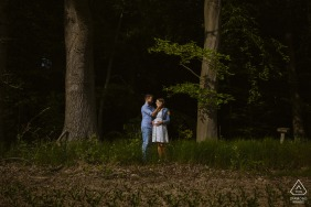 Aachen Engagement Portrait of a Couple - Image contains: woods, trees, forest, grass, embrace, hug