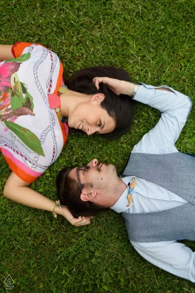 Arezzo, Parco Villa Severi engagement photoshoot session. A couple relaxing on the grass. Image contains: overhead, drone, fun, quirky