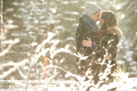 West Lake Tahoe Couple snuggling in the snow | Engagement Picture Session - Portrait contains: winter, jackets, beanie, hoods