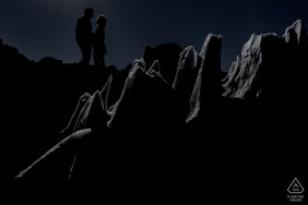 Atacama desert couple silhouette framed in ice floe during engagement photo session.