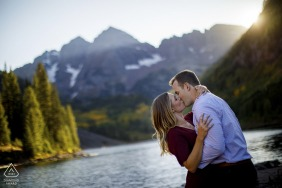 Maroon Lake, Aspen, CO portraits of a kissing couple near Maroon Lake during their engagement session.