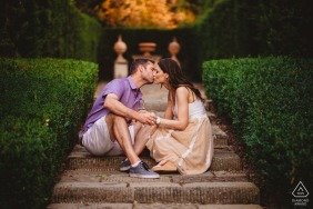 Vignamaggio, Florence, Tuscany Engagement Photography | Couple, sitting, kissing, steps, stairs, green, bushes
