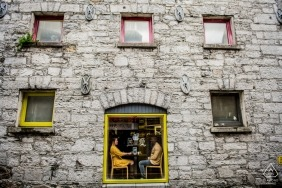 Engagement photography at a Coffee Shop in Galway	| A couple Sitting by the window