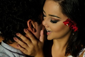 Teresopolis Engagement Photography Session - Image contains:bite, kiss, embrace, tight, shot flowers, hair, shadows