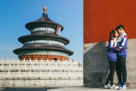 Beijing China Athletic Couple pose for an outdoor engagement portrait in the city.