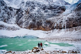 Mount Edith Cavell Glacier, Jasper National Park | Couple stands together in front of glacier during prewedding engagement portrait photoshoot