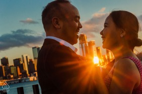 Weehawken New Jersey engagement photos with the city and the sun and the expressions.