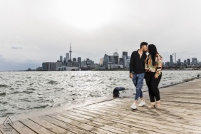 Polson Pier Engagement Photographer: Shoot for an adorable couple on the board walk - close to sunset time but with a cloud cover, the lake was a gleaming silver - I took this shot from closer to the lake level to catch the