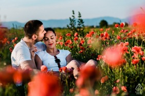 Sofia-Bulgaria Pre wedding day photo shoot for a couple sitting with flowers in the field