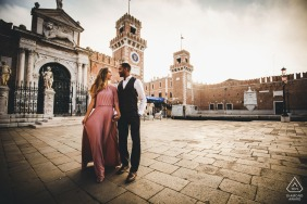 Venice pre-wedding shooting with a couple in the town village square near sunset.