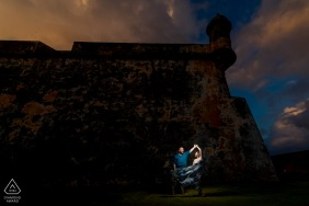 El Morro, San Juan PR engagement photographer: One light over couple and some dancing action.