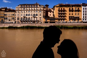 Silhouette couple portrait over River in Florence - Florence Italy city centre engagement shoot