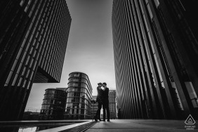 Düsseldorf Engagement pics in the city with tall buildings and a young couple in love