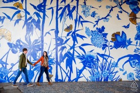 Chicago Illinois Engagement Photo - ping tom park couple walking in front of a mural