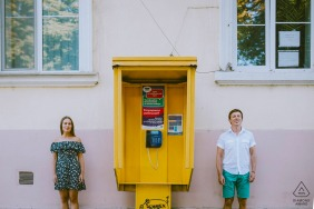 Odessa/Ukraine Prewedding Portraits - a phone box and the couple