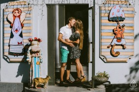 Odessa/Ukraine Wedding and Engagement Photographer: Couple portrait and a cat ın front of a gift shop
