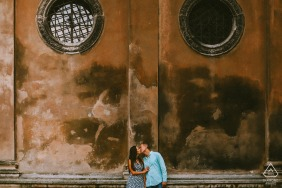 Lviv, Ukraine kissing couple in front of an old building during pre wedding engagement shoot session
