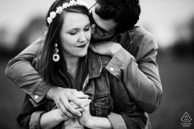 A black and white engagement photograph of a Mayenne couple holding each other.