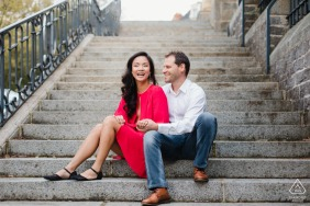 Mayenne Engagement Shoot | A couple sits on concrete steps for their session.