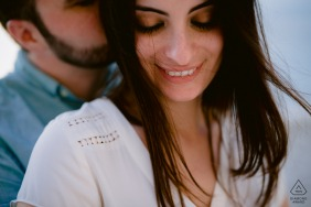 Tropea Engagement Session - Couple Picture with a Kiss in the Wind
