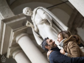 Milano engagement photo in Italy - Picture of a couple with a statue behind them