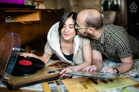 Istanbul couple enjoying some time together and playing vinyl records during their engagement photo shoot.