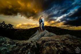"Photographer:""This rock formation is the staple of this park and the sky always has some incredible color around sunset. My assistant held a flash to help brighten the couple so I could darken down the rest of the scene and pull out the drama in the sky."""