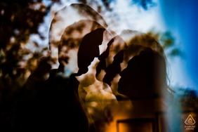 Longwood garden reflection image of engaged couple