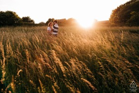 Devil's Dyke, nr Brighton, UK engagement picture - Romantic image of couple in long grass at golden hour
