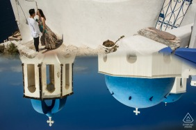 greece pre wedding image with buildins and sky reflection - santorini engagement shooting