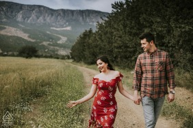 Turkey engagement shoot with a couple running on a dirt road - pre wedding image