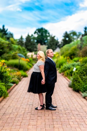 Engagement Photography | Denver Botanic Gardens, Denver, CO - Engaged couple stands back to back and admire the gardens - a Brenizer panorama