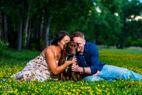 Engagement Picture Session from Sanitas Brewing, Boulder, CO - An engaged couple cuddles their dog in a field of flowers