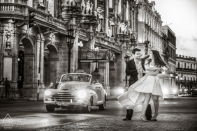 Engagement Picture Session at Havana, Cuba - A couple dancing in the middle of a street in front of Gran Teatro de La Habana in Cuba.
