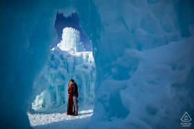 Engagement Photography Session at Dillon Ice Castles, Dillon, Colorado, USA - the couple braved the cold winter elements to create their dramatic engagement portraits in the ice castles in Colorado.