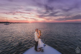Engaged Couples Photographer | Nantucket Harbor, Nantucket Island - A Couple on the bow of their friend's boat during sunset.