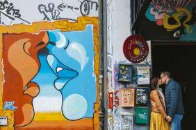 Couple Engagement Photos | Ljubljana Slovenia - A couple kissing on a kissing painting