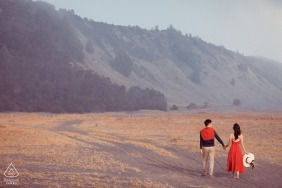 Bromo Mount Engagement Sessions | Autumn in Indonesia of couple walking toward the mountain