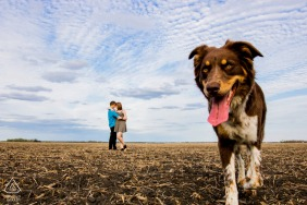 Harwood North Dakota engagement couple session - They embrace while Zoe walks into the image.