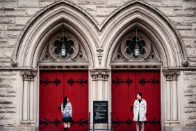 upper west side, nyc engagement portrait session with red gate doors of church