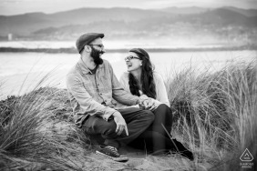 Marina Park, Ventura, California couple laughing together on the sand dunes during an engagement portrait session