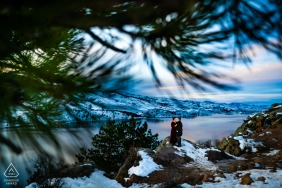 Engagement shoot of couple trying to stay warm as the sunsets during their winter engagement session at Horsetooth Reservoir in the foothills of Fort Collins, Colorado.