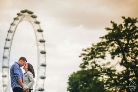 London pre-wedding shoot with the couple framed in a ferris wheel