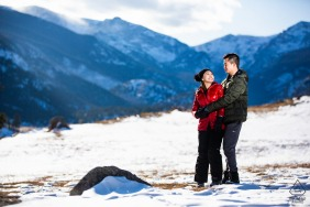 Rocky Mountain National Park, Estes Park, Colorado, USA	| The couple shares a joke as they cozy up together to stay warm in a frozen mountain valley