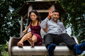 London, U.K. couples pre wedding photo shoot fun on a slide