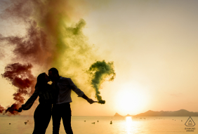 Aguilas - Spain engagement photographer - Beautiful sunset between smoke from flares and an unforgettable kiss